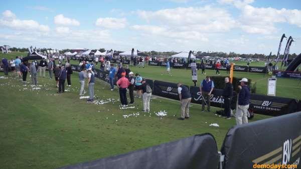 Golfers demo Titleist Golf clubs and balls